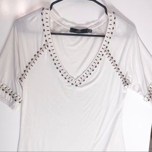 White v-neck with metal embellishments